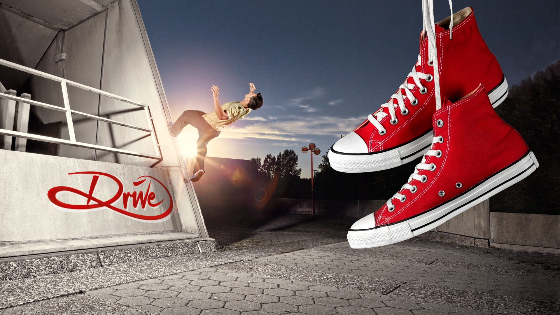 Freerunner mit hängenden Schuhen im Vordergrund